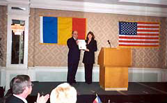 Acting Consul General of Romania in Los Angeles, Mr. Constantin Aron, and Dana Stanculescu, Honorary Consul of Romania in San Francisco presenting Proclamation by Mayor Willie Brown on December 1, 2000 in Los Angeles. [ View Proclamation ]